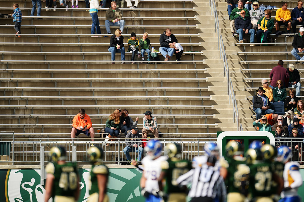 . FORT COLLINS, CO - OCTOBER 12 : Colorado State fans watch the game against San Jose State from sparsely populated areas of Hughes Stadium. Fort Collins. Colorado. October 12, 2013. San Jose won 34-27. (Photo by Hyoung Chang/The Denver Post)