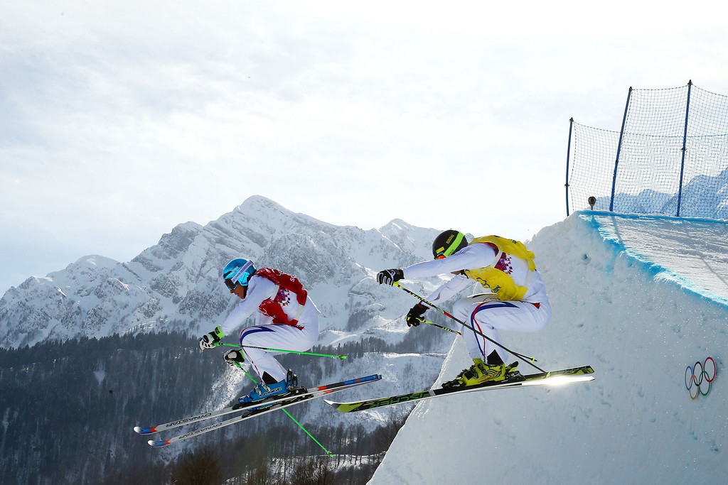 . (L-R) Jean Frederic Chapuis of France (red bib) and Jonathan Midol of France (yellow bib) compete during the Freestyle Skiing Men\'s Ski Cross 1/8 Finals on day 13 of the 2014 Sochi Winter Olympic at Rosa Khutor Extreme Park on February 20, 2014 in Sochi, Russia.  (Photo by Cameron Spencer/Getty Images)