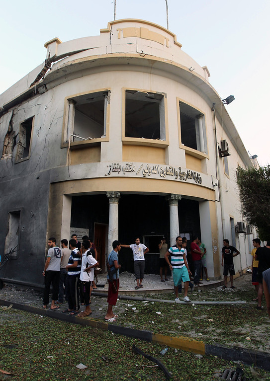 . Libyans gather outside a foreign ministry building that was damaged by a powerful blast on September 11, 2013 in the eastern Libyan city of Benghazi. The explosion comes on the first anniversary of an attack by militants on the United States consulate in Benghazi, which killed four Americans, including the ambassador. ABDULLAH DOMA/AFP/Getty Images