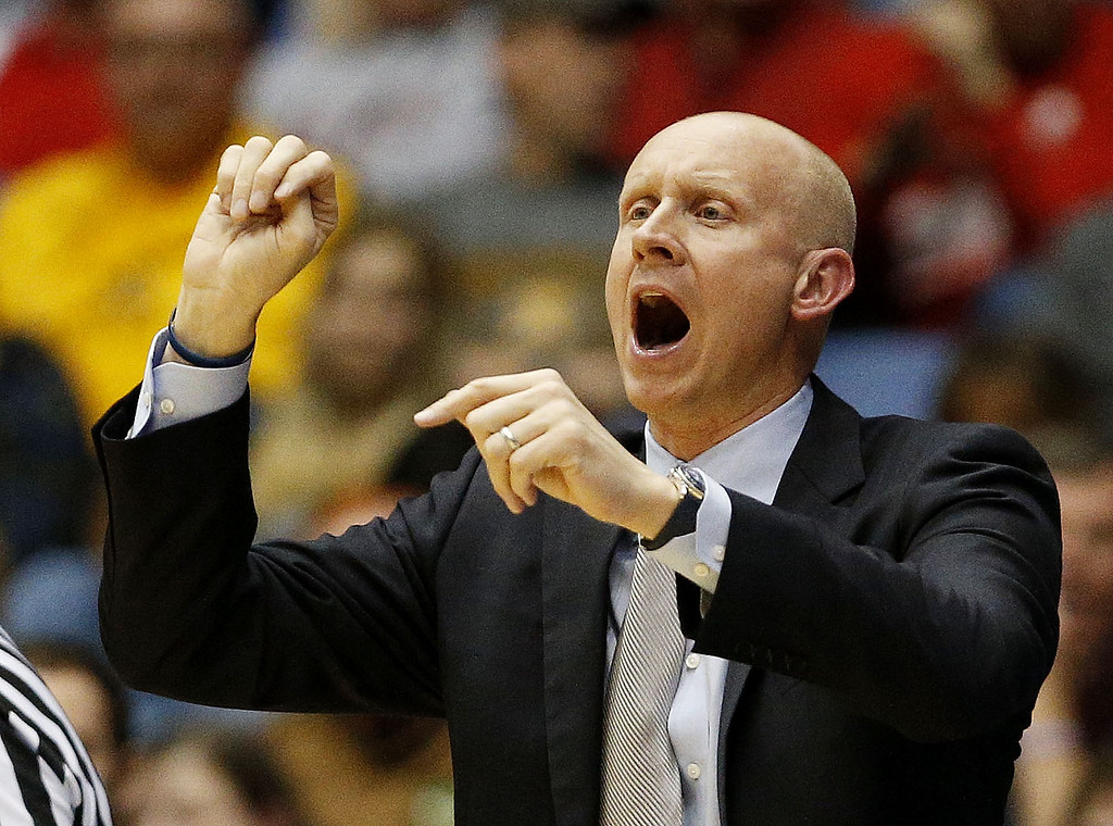 . Head coach Chris Mack of the Xavier Musketeers reacts in the second half against the North Carolina State Wolfpack during the first round of the 2014 NCAA Men\'s Basketball Tournament at at University of Dayton Arena on March 18, 2014 in Dayton, Ohio.  (Photo by Gregory Shamus/Getty Images)