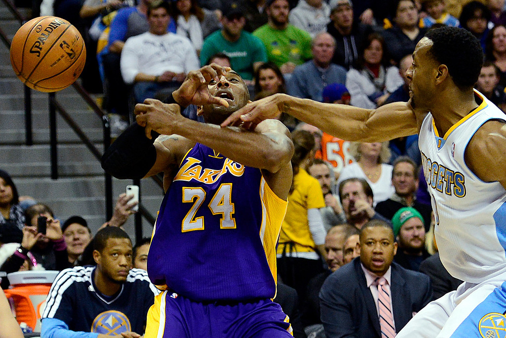 . Denver Nuggets shooting guard Andre Iguodala (9) pokes the ball away from Los Angeles Lakers shooting guard Kobe Bryant (24) during the second half of the Nuggets\' 126-114 win at the Pepsi Center on Wednesday, December 26, 2012. AAron Ontiveroz, The Denver Post