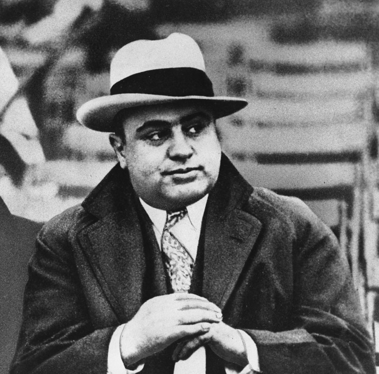 . In this file photo taken Jan. 19, 1931, mobster Al Capone is photographed at a football game. As Illinois Gov. Pat Quinn considers signing a bill into legislation that would allow legal gambling for the first time in Chicago, opponents of the bill fear that political corruption and crime syndicate infiltration will follow. (AP Photo)