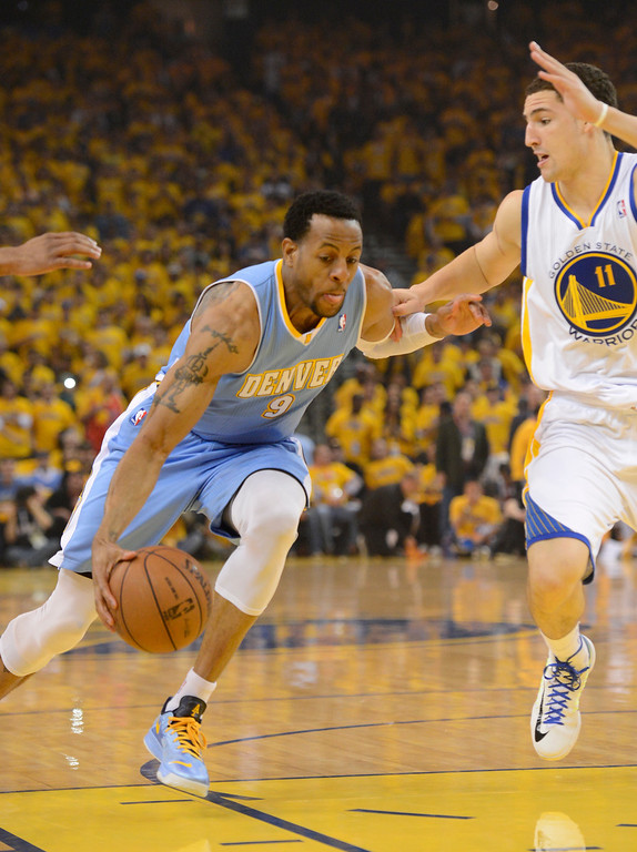 . OAKLAND, CA. - APRIL 26: Andre Iguodala (9) of the Denver Nuggets drives on Klay Thompson (11) of the Golden State Warriors during the first quarter in game 3 of the first round of the NBA Playoffs April 26, 2013 at Oracle Arena.  (Photo By John Leyba/The Denver Post)