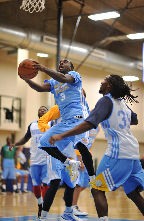 . Ty Lawson of Denver Nuggets (3) drives the ball against Kenneth Faried (35) during the practice. The Denver Nuggets take the court for their first official practice under new coach Brian Shaw at Pepsi Center. Denver, Colorado. October 1, 2013. (Photo by Hyoung Chang/The Denver Post)