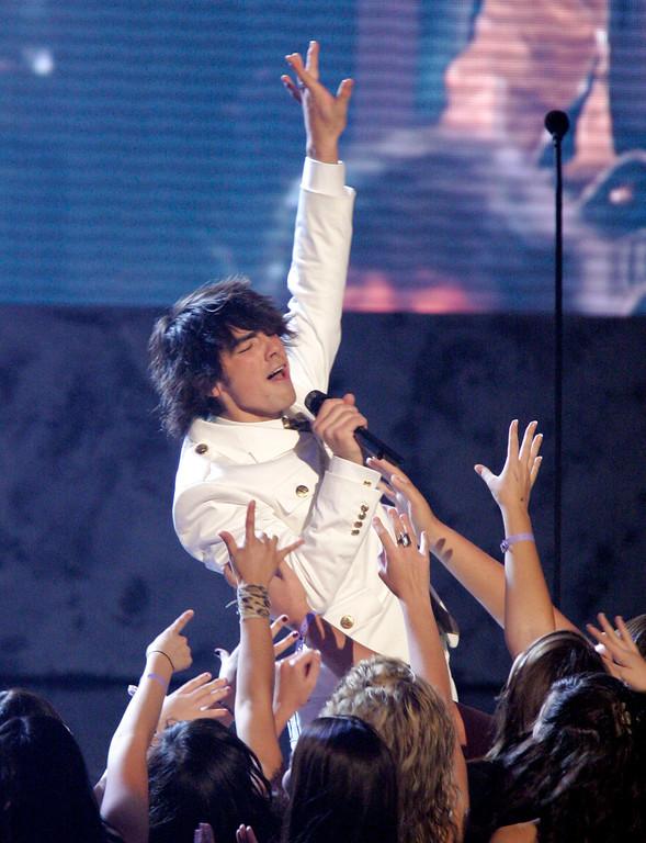 . Joe Jonas, of the Jonas Brothers, performs at the American Music Awards in Los Angeles on Sunday, Nov. 18, 2007. (AP Photo/Mark J. Terrill)