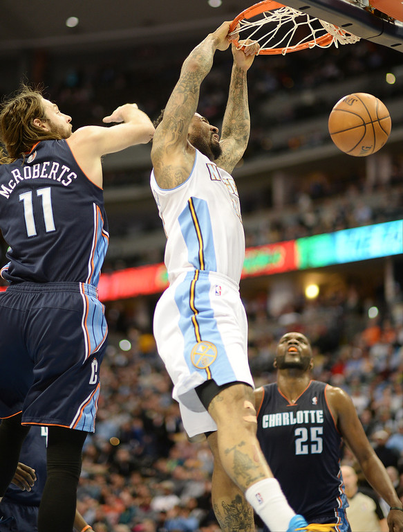 . Wilson Chandler of the Denver Nuggets (21) dunks in the second half of the game.  (Photo by Hyoung Chang/The Denver Post)