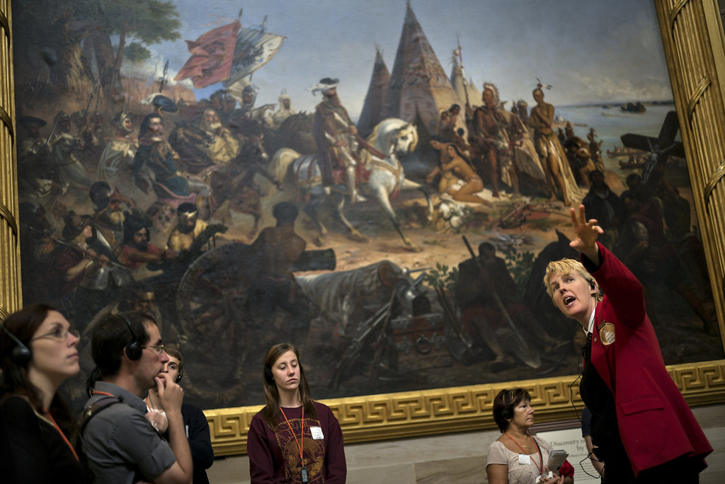 . Tourists listen to a tour guide speak in the Rotunda of the US Capitol Building on Capitol Hill October 17, 2013 in Washington, DC. The US federal government reopened today after a 16 day forced shutdown. AFP PHOTO/Brendan  SMIALOWSKI/AFP/Getty Images