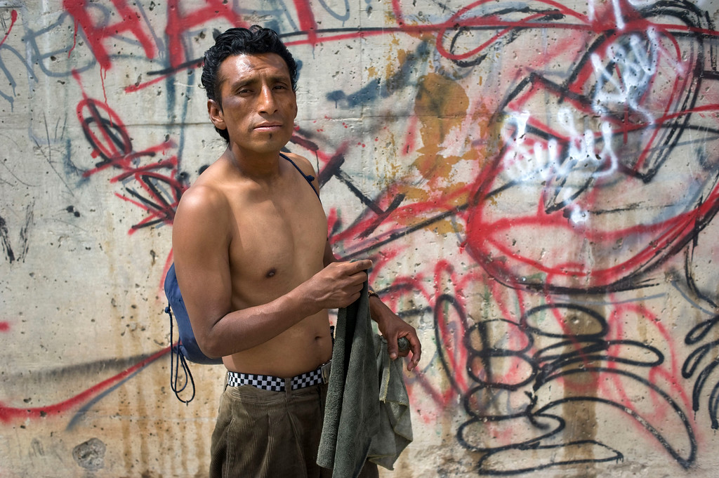 . Arturo Gonzalez Padilla, 30, poses for a photograph holding two pieces of cloth he uses to clean cars to make a living, in Tijuana, Mexico, 03 May 2013. Gonzalez, who spent much of his life living undocumented in the US, was deported two years ago and has since been living homeless in the Tijuana River canal. Heightened US border security and record numbers of deportations from the US have created a growing population of people who live homeless in Mexican cities that border with the United States. Many had lived for years undocumented in the US and have little or no family and other support in Mexico, and are subject to fall into depression, substance abuse and crime. Tijuana, Mexico, borders on the US city of San Diego, California.  EPA/DAVID MAUNG