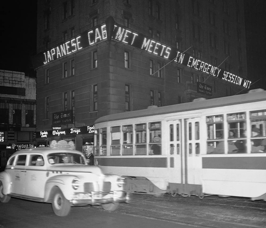 ". ""Japanese cabinet meets in emergency session,\"" is the bulletin shown in Times Square\'s news zipper in lights on the New York Times building, New York, Dec. 7, 1941. (AP Photo/Robert Kradin)"