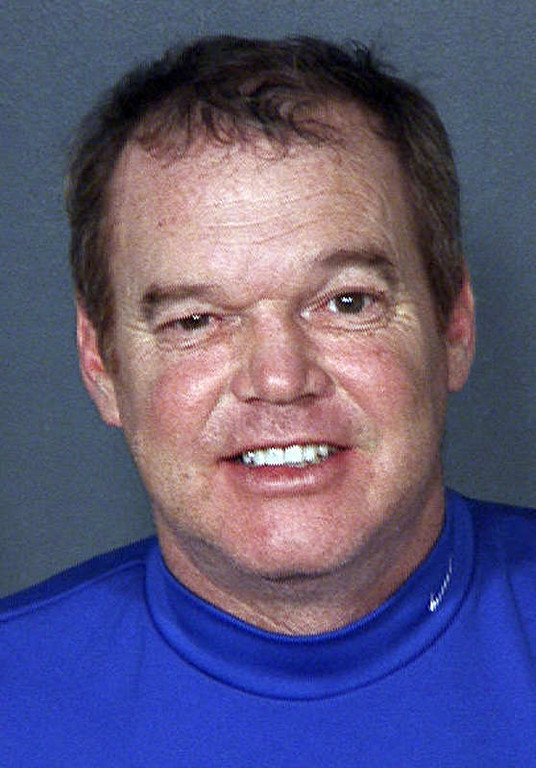 . This undated Clark County Detention Center booking mug photo released by the Las Vegas Police Department shows Al Unser Jr. Unser has been suspended indefinitely from his job as an IndyCar driving coach after his arrest early Thursday morning on drunken driving and reckless driving charges in New Mexico. Bernalillo County Sheriff\'s spokeswoman Jennifer Brown says the 49-year-old was drag racing another car in his Suburban in Albuquerque and was going around 101 mph before sheriff\'s deputies caught up to him. (AP Photo/Las Vegas Police Department)