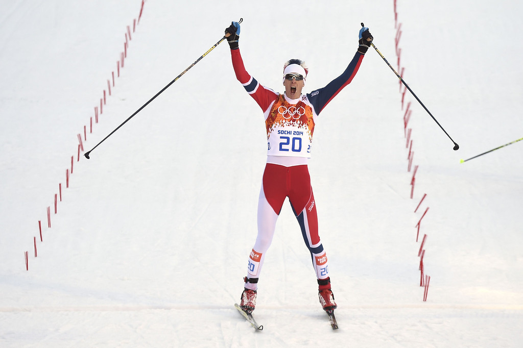 . Norway\'s Magnus Krog celebrates winning bronze at the finish line of the Nordic Combined Individual NH / 10 km Cross-Country at the RusSki Gorki Jumping Center during the Sochi Winter Olympics on February 12, 2014 in Rosa Khutor near Sochi. AFP PHOTO / ODD ANDERSEN/AFP/Getty Images