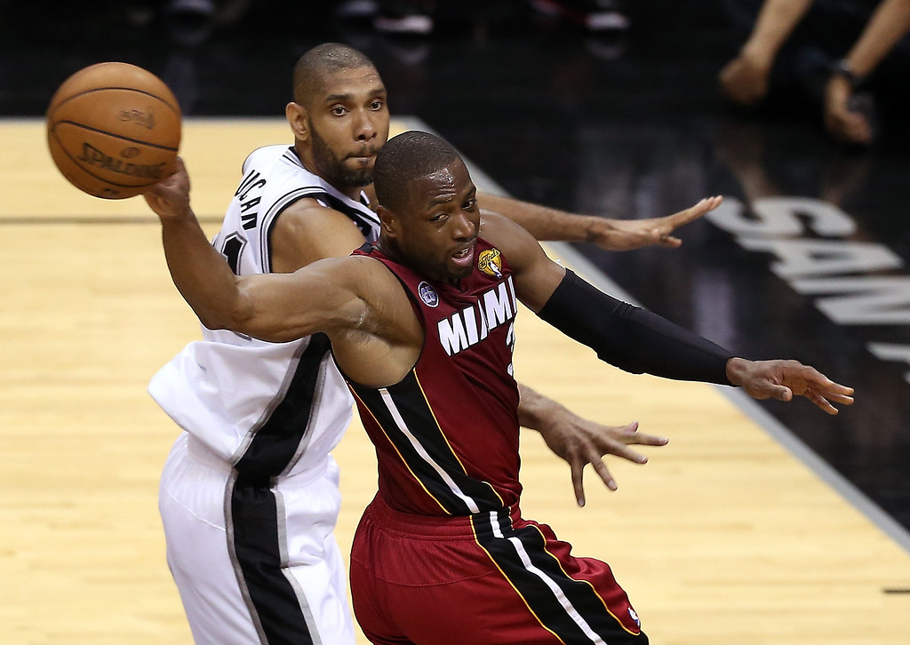 . Dwyane Wade #3 of the Miami Heat passes the ball against Tim Duncan #21 of the San Antonio Spurs in the first half during Game Three of the 2013 NBA Finals at the AT&T Center on June 11, 2013 in San Antonio, Texas.   (Photo by Christian Petersen/Getty Images)