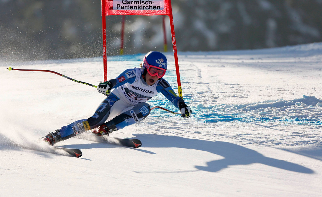 . Laurenne Ross of the U.S. casts a shadow as she speeds down to take the second place in the women\'s Alpine Skiing World Cup Downhill race in Garmisch-Partenkirchen March 2, 2013.  REUTERS/Wolfgang Rattay