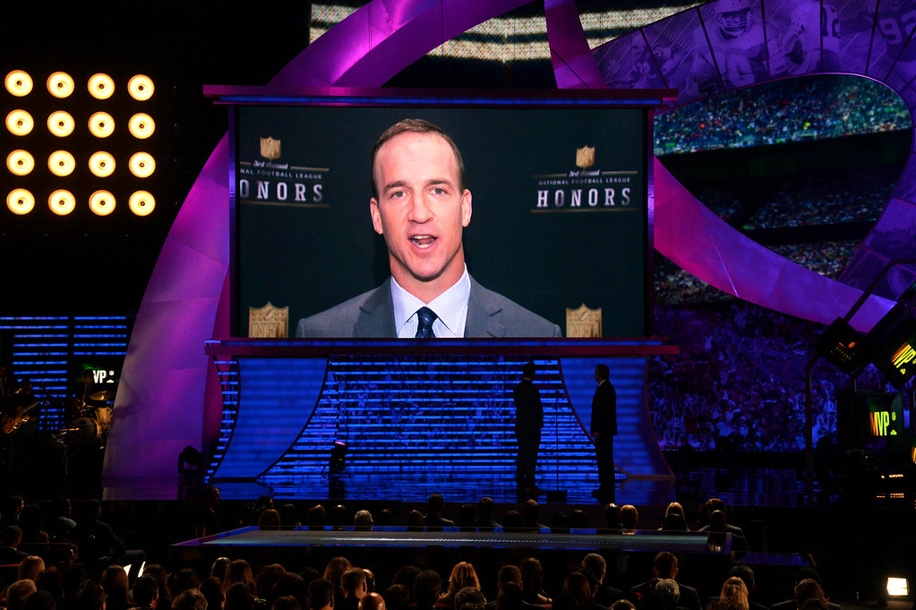 . Peyton Manning of the Denver Broncos appears onscreen to accept the award for AP Most Valuable Player, at the third annual NFL Honors at Radio City Music Hall on Saturday, Feb. 1, 2014, in New York. (Photo by Evan Agostini/Invision for NFL/AP Images)