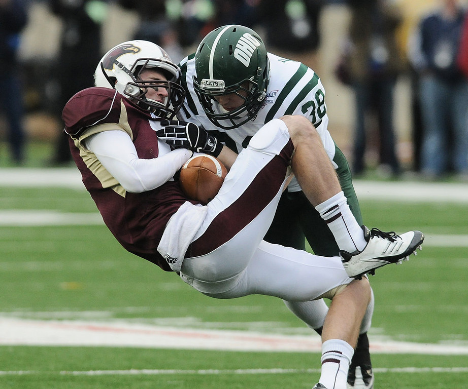 . Ohio\'s Keith Moore hits Louisiana-Monroe\'s Brent Leonard during the first quarter of the Independence Bowl NCAA college football game, Friday, Dec. 28, 2012, in Shreveport, La. (AP Photo/The Shreveport Times, Douglas Collier)