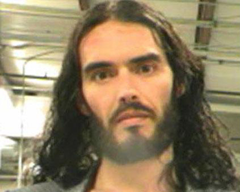 """. This mugshot released by the Orleans Parish Sheriff\'s Office on March 16, 2012, shows British comedian Russell Brand. Brand was free on bond after turning himself into New Orleans police to face criminal charges for snatching a paparazzo\'s iPhone and firing it at the window of a nearby office. \""""He\'s been booked. He posted bond and he was released within an hour of his arrest,\"""" New Orleans police spokesman Frank Robertson told AFP. Brand faces misdemeanor charges of \""""simple criminal damage to property\"""" and was released on a $5,000 bond Thursday.    -/AFP/Getty Images)"""