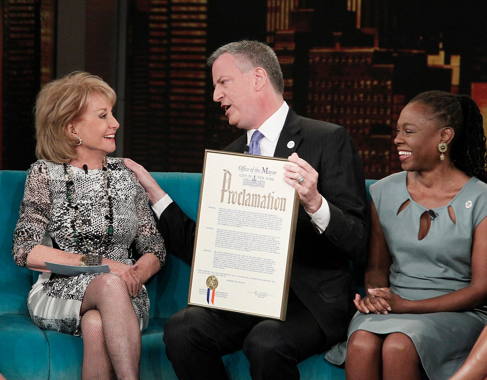 """. This image released by ABC shows host Barbara Walters, left, with New York City Mayor Bill de Blasio and his wife Chirlane McCray on ABC\'s \""""The View,\"""" Monday, April 21, 2014 in New York. De Blasio is proclaiming May 16 as \'Barbara Walters Day\' in New York City.  Walters is retiring that day after a storied television reporting career that has spanned five decades.  (AP Photo/ABC, Lou Rocco)"""