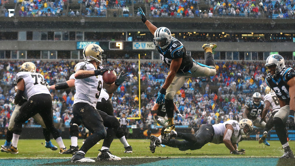 . Greg Hardy #76 of the Carolina Panthers goes after Drew Brees #9 of the New Orleans Saints during their game at Bank against the Carolina Panthers of America Stadium on December 22, 2013 in Charlotte, North Carolina.  (Photo by Streeter Lecka/Getty Images)