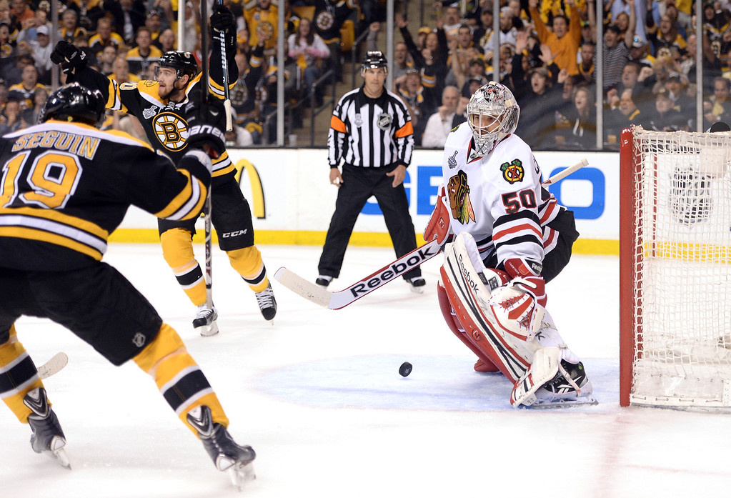 . Tyler Seguin #19 and Daniel Paille #20 of the Boston Bruins react after a goal in the first period by Rich Peverley #49 (not pictured) against Corey Crawford #50 of the Chicago Blackhawks in Game Four of the 2013 NHL Stanley Cup Final at TD Garden on June 19, 2013 in Boston, Massachusetts.  (Photo by Harry How/Getty Images)
