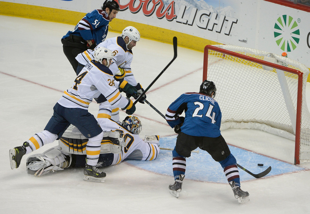 . Colorado Avalanche center, Marc-Andre Cliche, right, beats Buffalo Sabres goalie, Ryan Miller, and scores in the Saturday afternoon, February 01, 2014. The Avalanche won 7-1. (Photo By Andy Cross / The Denver Post)