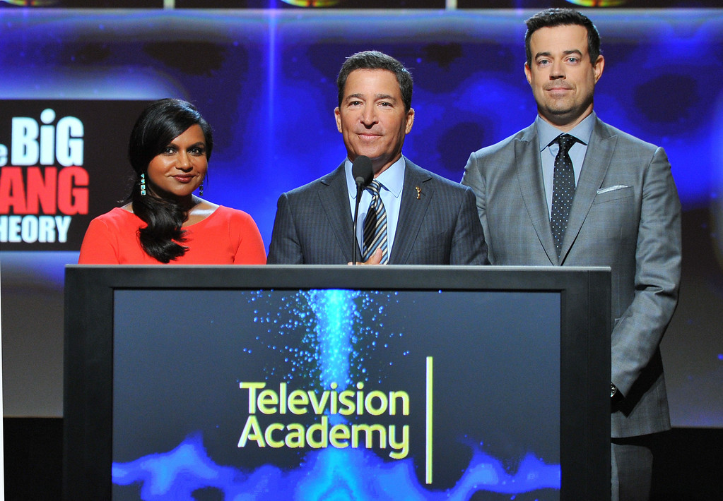 . Actress Mindy Kaling, and from left, Television Academy Chairman and CEO Bruce Rosenblum, and TV host Carson Daly announce the award nominees at the 66th Primetime Emmy Nominations Announcement on Thursday, July 10, 2014, at the Leonard H. Goldenson Theater in the NoHo Arts District in Los Angeles. (Photo by Vince Bucci/Invision for the Television Academy/AP Images).