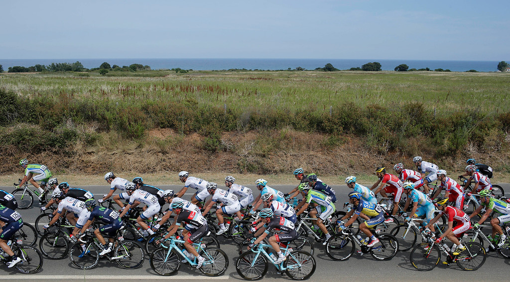 . The pack with the Argos-Shimano team of stage winner and new overall leader Marcel Kittel of Germany, in white shirts, ride during the first stage of the Tour de France cycling race over 213 kilometers (133 miles) with start in Porto Vecchio and finish in Bastia, Corsica island, France, Saturday June 29, 2013. (AP Photo/Laurent Cipriani)