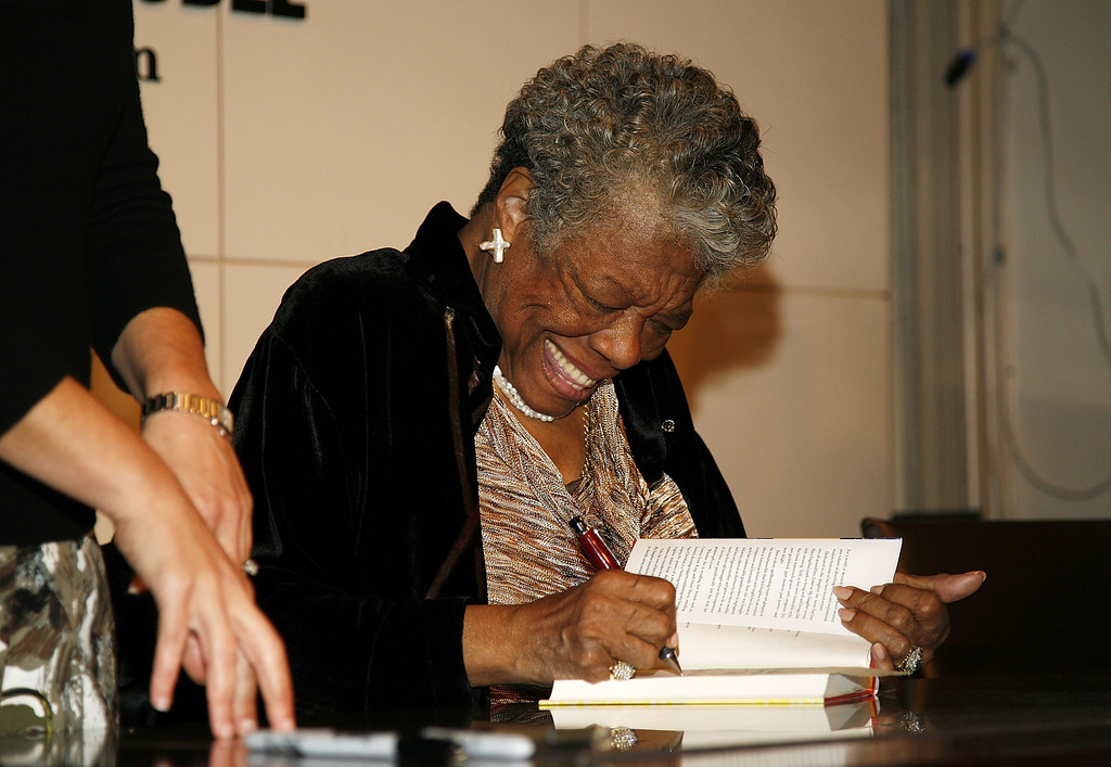 ". NEW YORK - OCTOBER 30: Maya Angelou signs copies of ""Maya Angelou: Letter to My Daughter\"" at Barnes & Noble in Union Square on October 30, 2008 in New York City.  (Photo by Gabriela Maj/Getty Images)"