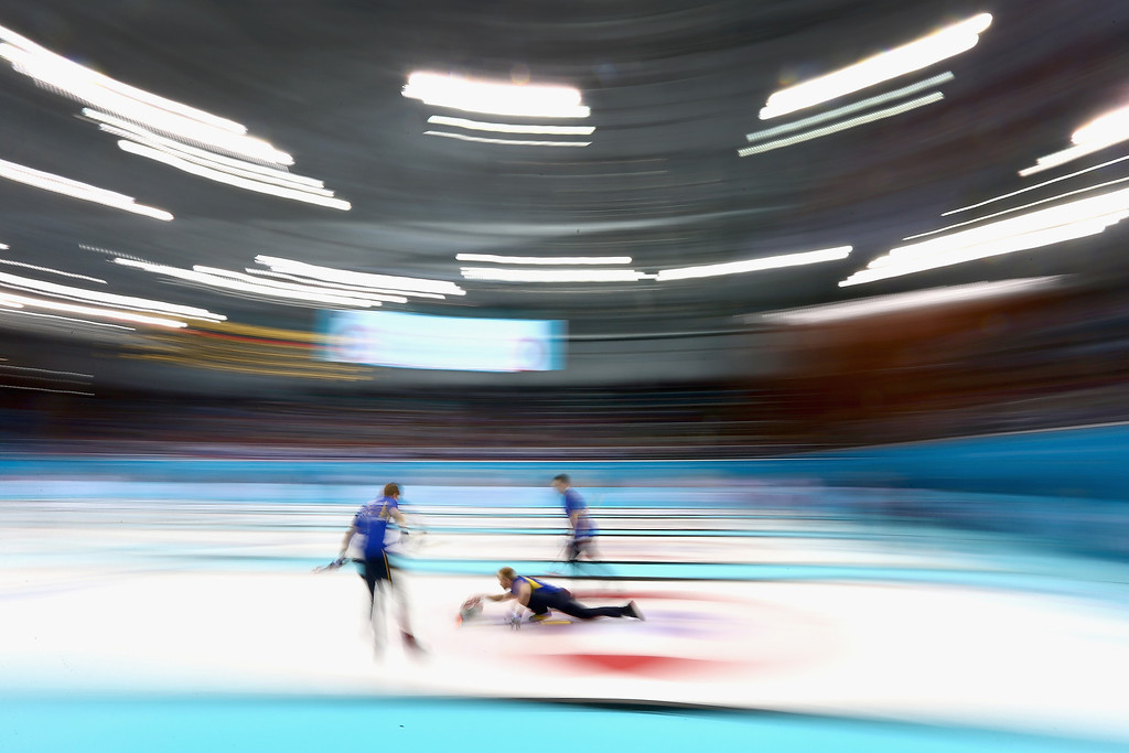 . Niklas Eden of Sweden in action during the round robin match against Great Britain during day 3 of the Sochi 2014 Winter Olympics at Ice Cube Curling Center on February 10, 2014 in Sochi, Russia.  (Photo by Clive Mason/Getty Images)