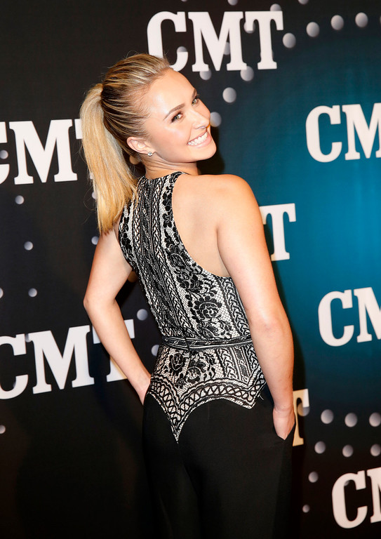""". Hayden Panettiere, of ABC\'s \""""Nashville,\"""" poses on the red carpet at the CMT \""""Artists of the Year\"""" at Bridgestone Arena, on Tuesday, Dec. 3, 2013, in Nashville, Tenn. (Photo by Donn Jones/Invision/AP)"""