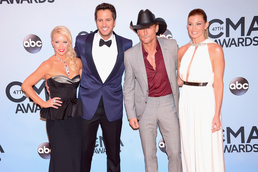 . NASHVILLE, TN - NOVEMBER 06:  Caroline Boyer, Luke Bryan, Tim McGraw and Faith Hill attend the 47th annual CMA Awards at the Bridgestone Arena on November 6, 2013 in Nashville, Tennessee.  (Photo by Michael Loccisano/Getty Images)