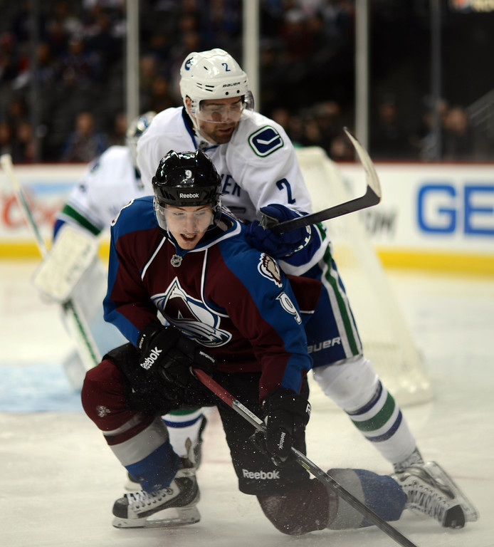 . DENVER, CO. - APRIL 13 : Matt Duchene of Colorado Avalanche (9) and Dan Hamhuis of Vancouver Canucks (2) are in action in the 1st period of the game at Pepsi Center. Denver, Colorado. April 13, 2013. Colorado won 4-3. (Photo By Hyoung Chang/The Denver Post)