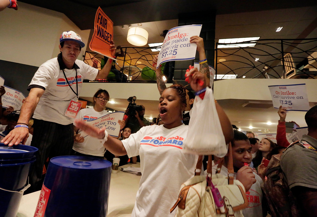 . Protesting fast food workers fill a McDonald\'s restaurant on New York\'s Fifth Avenue, Thursday, Aug. 29, 2013. (AP Photo/Richard Drew)