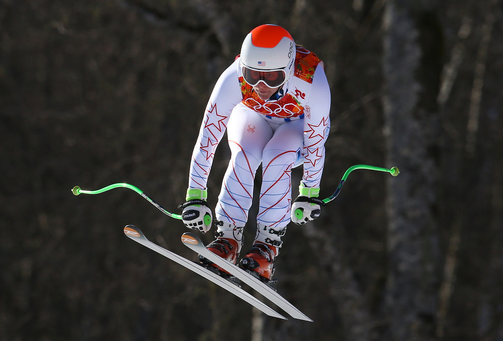 . United States\' Stacey Cook makes a jump during the women\'s downhill at the Sochi 2014 Winter Olympics, Wednesday, Feb. 12, 2014, in Krasnaya Polyana, Russia. (AP Photo/Alessandro Trovati)