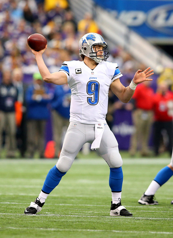 . Matthew Stafford #9 of the Detroit Lions passes the ball for a gain against the Minnesota Vikings on December 29, 2013 at Mall of America Field at the Hubert H. Humphrey Metrodome in Minneapolis, Minnesota. (Photo by Adam Bettcher/Getty Images)