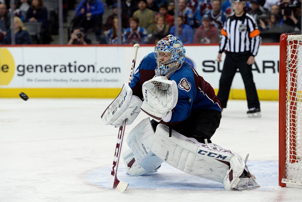 . Colorado Avalanche goalie Semyon Varlamov (1) goes for a glove save during the second period.   (Photo by John Leyba/The Denver Post)