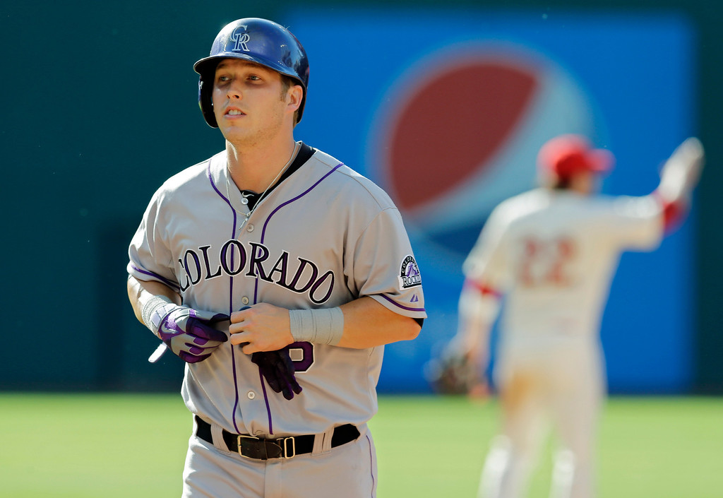 . Colorado Rockies\' Corey Dickerson walks off the field after he was out on the front end of a game-ending double play in the ninth inning of a baseball game against the Cleveland Indians Saturday, May 31, 2014, in Cleveland. Cleveland won 7-6. (AP Photo/Mark Duncan)
