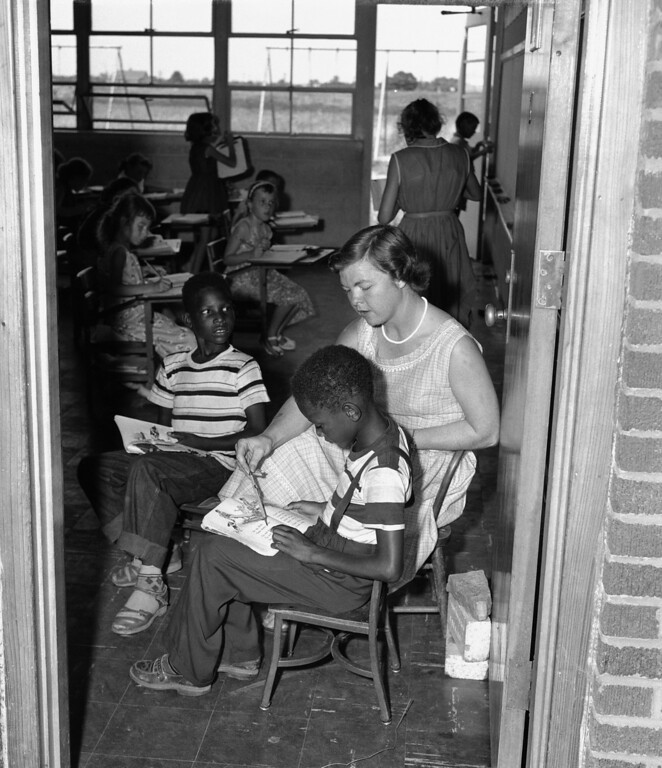 . White and black grade school youngsters study together in harmony at the consolidated school in Hoxie, Ark.,  Aug 15, 1955. The community of 1,855 de-segregated its school last July by taking in 23 black students. (AP Photo)