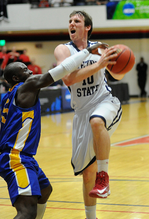 . DENVER, CO. - MARCH 19: Rattlers senior guard Moses Sundufu (15) caught Roadrunners guar guard Mitch McCarron (10) on the arm as he drove to the basket in the first half. The Metro State men\'s basketball team hosted St. Mary\'s (Texas) in a RMAC playoff game Tuesday night, March 19, 2013. (Photo By Karl Gehring/The Denver Post)