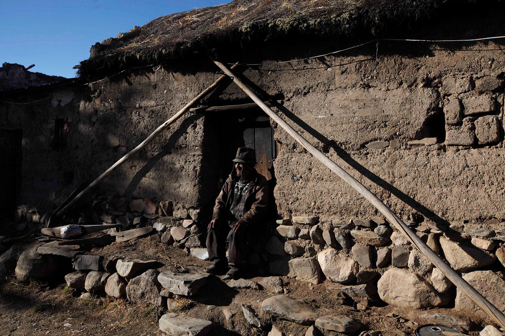 . Carmelo Flores Laura, a native Aymara, sits outside his home in the village of Frasquia, Bolivia, Tuesday, Aug. 13, 2013. If Boliviaís public records are correct, Flores is the oldest living person ever documented. They say he turned 123 a month ago. His grandson, Edwin, says he fought in the 1933 Chaco war with Paraguay but he said he only faintly remembers that. (AP Photo/Juan Karita)