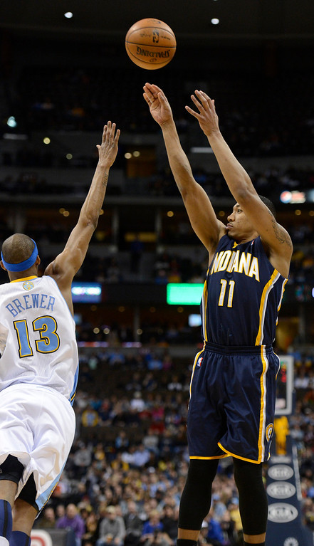 . DENVER, CO. - JANUARY 28: Indiana Pacers shooting guard Orlando Johnson (11) takes a shot over Denver Nuggets small forward Corey Brewer (13) during the first quarter January 28, 2013 at Pepsi Center. The Denver Nuggets host the Indiana Pacers in NBA action.  (Photo By John Leyba / The Denver Post)