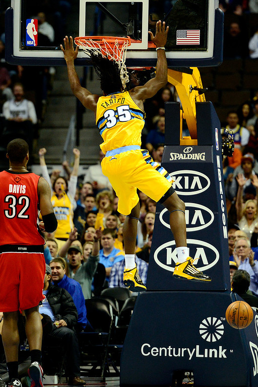 . Denver Nuggets small forward Kenneth Faried (35) hits the glass after dunking on the Toronto Raptors during the second half of the Nuggets\' 113-110 win at the Pepsi Center on Monday, December 3, 2012. AAron Ontiveroz, The Denver Post