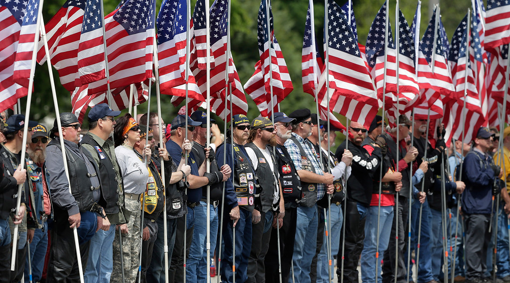. Members of the Patriot Guard line the road for  a procession prior to a memorial service for first responders who died in last week\'s fertilizer plant explosion in West, Texas, Thursday, April 25, 2013, in Waco, Texas.  President Barack Obama, U.S. Sen. John Cornyn and Texas Gov. Rick Perry are set to speak at Thursday\'s memorial at Baylor University\'s Ferrell Center in Waco. Firefighters and other first responders were among those killed when a fire at the plant erupted in an explosion last week. Hundreds of people were injured.  (AP Photo/Eric Gay)