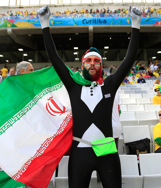 . An Iranian fan waits for the start of the group F World Cup soccer match between Iran and Nigeria at the Arena da Baixada in Curitiba, Brazil, Monday, June 16, 2014.  (AP Photo/Frank Augstein)