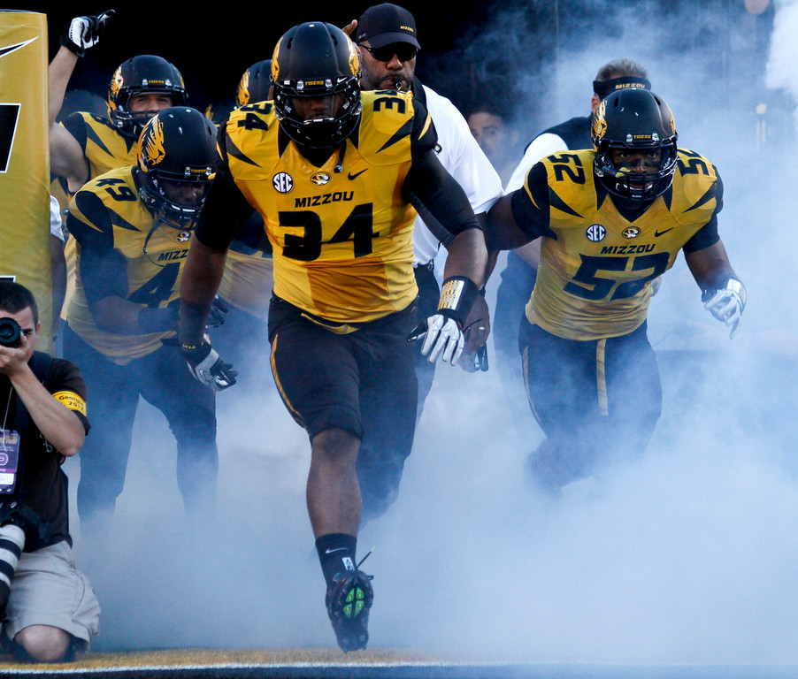 . Sheldon Richardson #34 of the Missouri Tigers leads his team onto the field before their game against the Georgia Bulldogs at Memorial Stadium on September 8, 2012 in Columbia, Missouri. (Photo by Ed Zurga/Getty Images)