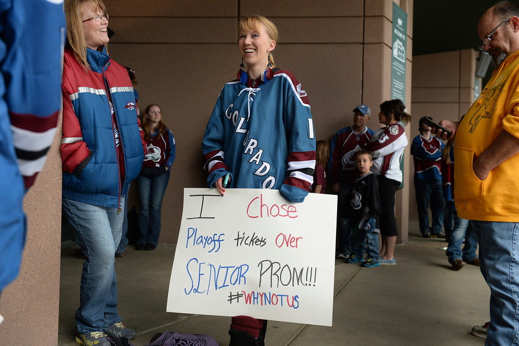 . Meghan Poulsen and her mom Terri, left, waited outside the Pepsi Center for the arena to open. Meghan had the choice between going to prom or going to the Avs game and chose the hockey team. The Colorado Avalanche hosted the Minnesota Wild at the Pepsi Center Saturday night, April 19, 2014 in an NHL playoff game. (Photo by Karl Gehring/The Denver Post)