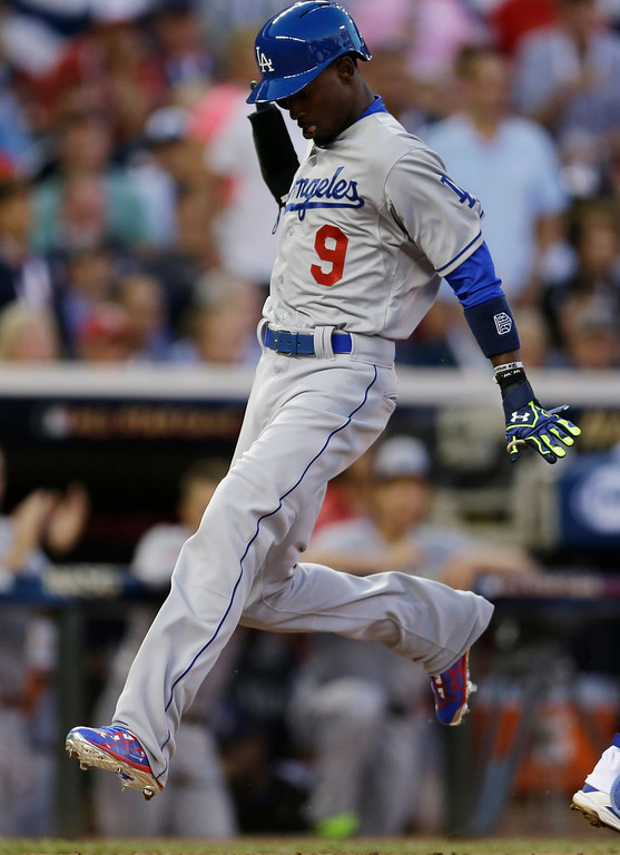 . National League\'s Dee Gordon, of the Los Angeles Dodgers, scores during the fourth inning of the MLB All-Star baseball game, Tuesday, July 15, 2014, in Minneapolis. (AP Photo/Jeff Roberson)