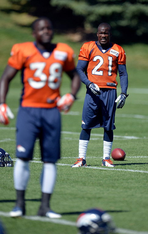 . Denver Broncos running back Montee Ball (38) and Denver Broncos running back Ronnie Hillman (21) stretch before practice  August 26, 2013 at Dove Valley. (Photo by John Leyba/The Denver Post)