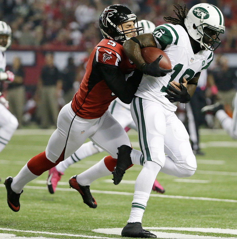 . Atlanta Falcons punter Matt Bosher (5) tackles New York Jets wide receiver Clyde Gates (19) during the first half of an NFL football game, Monday, Oct. 7, 2013, in Atlanta. (AP Photo/David Goldman)