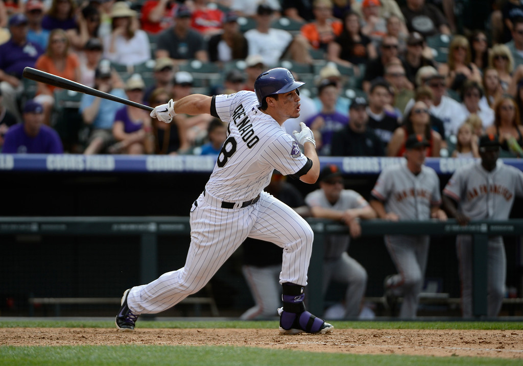 . DENVER, CO - JUNE 27: Colorado Rockies third baseman, Nolan Arenado hits a walk-off game winning single to defeat the San Francisco Giants 2-1 at Coors Field Saturday afternoon, June 29, 2013. (Photo By Andy Cross/The Denver Post)