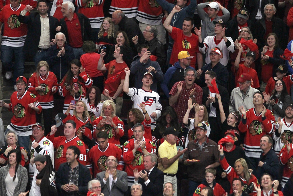 . Chicago Blackhawks fans cheer during Game Five of the Western Conference Final against the Los Angeles Kings in the 2014 Stanley Cup Playoffs at United Center on May 28, 2014 in Chicago, Illinois.  (Photo by Tasos Katopodis/Getty Images)